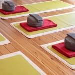 Close-up of yoga mats and yoga cushion in a yoga studio